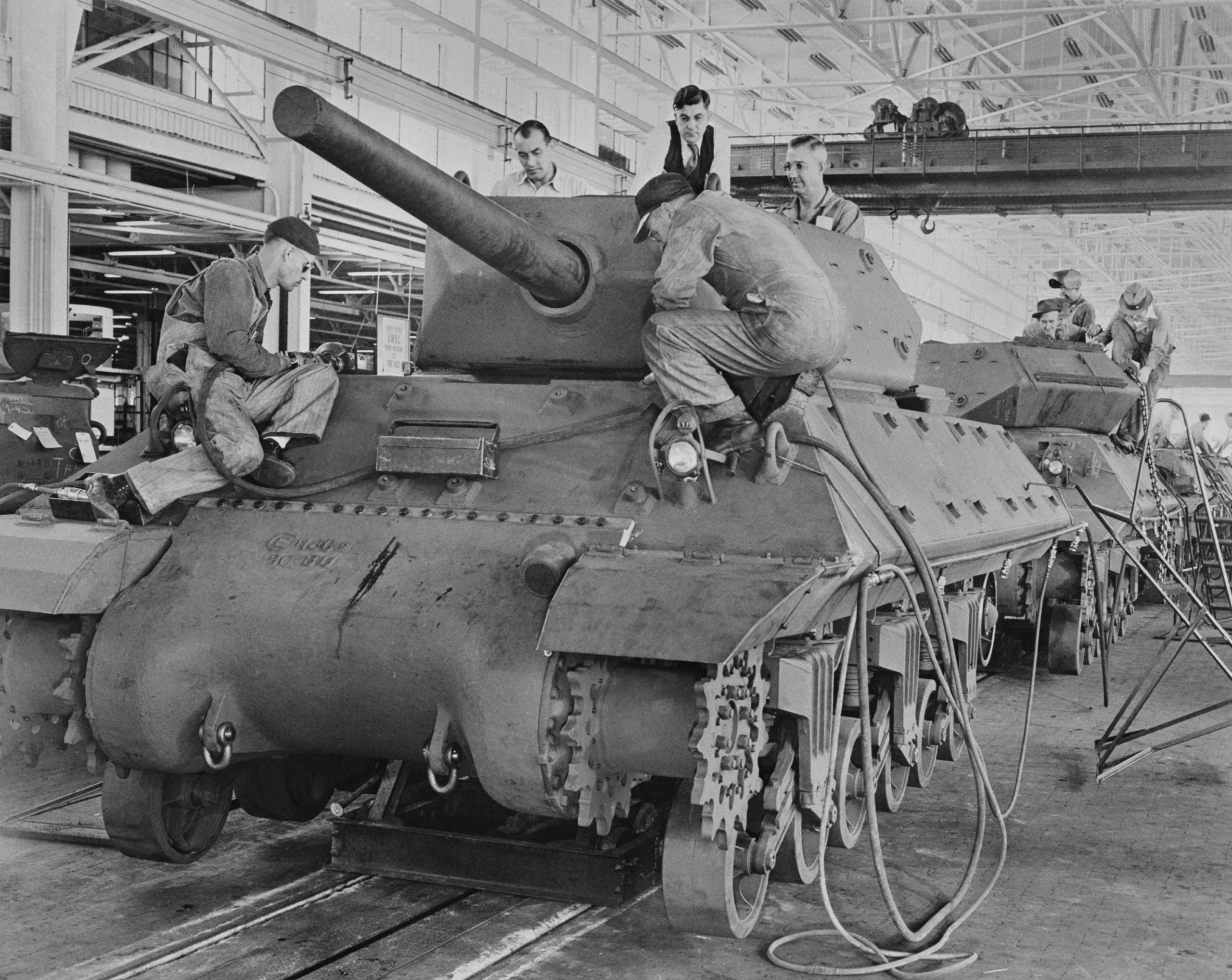 Factory workers building a Sherman Tank during World War 2