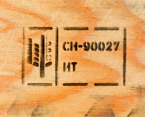 picture of a standard ISPM-15 marking on wood background