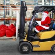 Santa Claus driving a forklift
